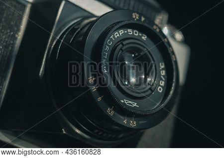 Close-up Of The Soviet Manual Lens Industar 50-2 On A Film Camera Zenit-e. Black Background, Selecti