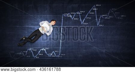 Business graph and trade monitor background and businessman . Mixed media