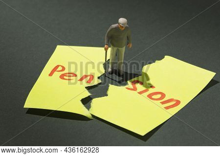 Elderly Man With A Crutch And A Torn Sheet Of Paper With Text, Concept On The Topic Of No Pension In