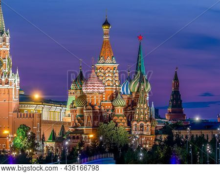 St. Basils Cathedral In Moscow. A Colorful Evening Shot With A Purple Sky For A Postcard Or Calendar
