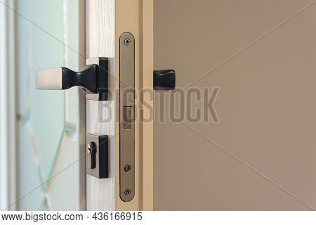 White Wooden Modern Door. Stainless Door Knob. Handle On Wooden Door, Closeup