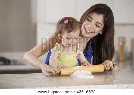 Helping mom cook dinner