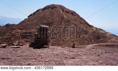 Rock Cairn In The Mountains, Selective Focus On The Rocks. Background Is Purposely Blurred