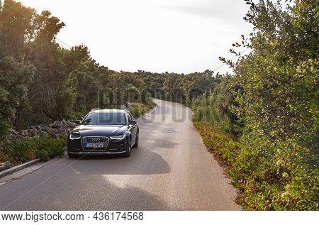 Vir, Croatia - July 27, 2021: Black Audi A6 On The Road At The Island Of Vir, Croatia.