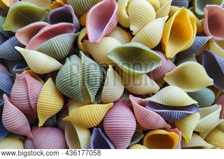 Close-up On A Stack Of Colorful Conchiglie From Veneto In Italy.