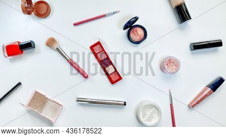 Beauty Concept. Makeup Products Shadows, Highlighter, Blush, Brushes, Powder, Glitter, Mascara, Glos