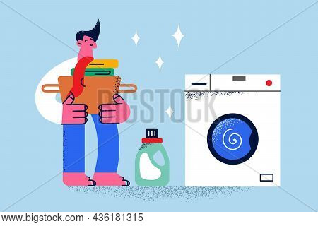 Laundry Service And Housework Concept. Young Smiling Man Cartoon Character Standing Holding Basket W