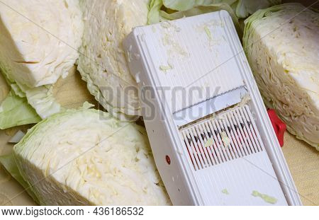 Heads Of Cabbage And Slicing Grater Close-up