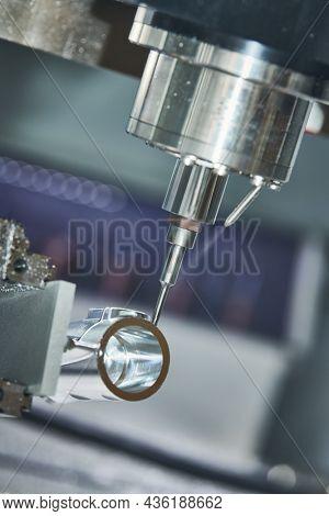 Precision machining metal detail on CNC milling machine
