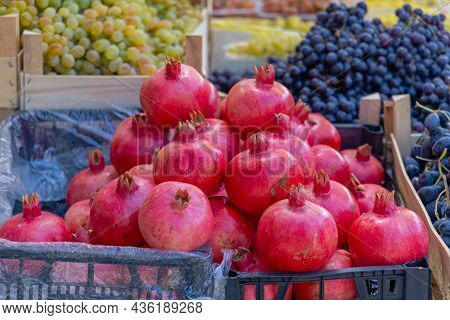 Red Pomegranate Fruits At Farmers Market Stall