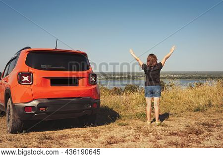 Young Happy Woman Outdoors Near The Car Enjoying A Warm Summer Day