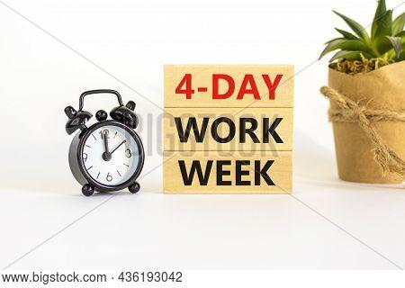 4-day Work Week Symbol. Concept Words '4-day Work Week' On Wooden Blocks. Black Alarm Clock, House P