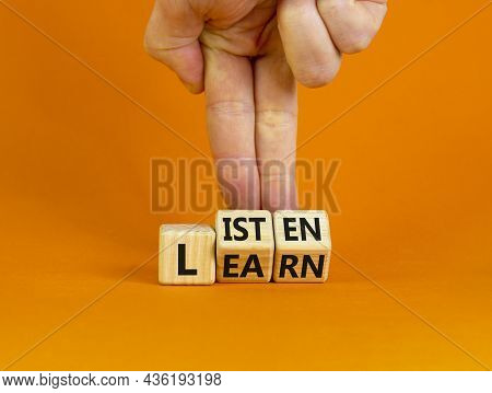 Listen And Learn Symbol. Businessman Turns Wooden Cubes And Changes A Concept Word 'listen' To 'lear