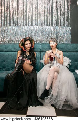 Minsk. Belarus. 10.13.2021. Halloween Party. Two Girls In Special Outfits And Professional Makeup Lo