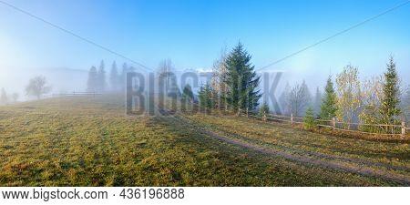 Foggy Autumn Mountain Sunrise Scene. Peaceful Picturesque Traveling, Seasonal, Nature And Countrysid