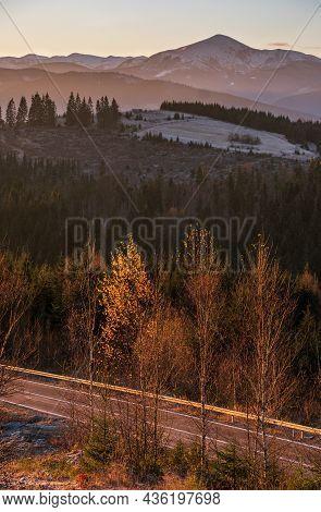 Picturesque Sunrise Above Late Autumn Mountain Countryside.  Ukraine, Carpathian Mountains. Peaceful