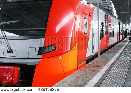 A High-speed Red-gray Electric Train Is Standing On The Platform. High-tech Transport