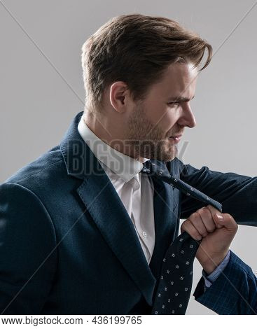 Professional Man Manager In Suit Being Pulled By Necktie During Workplace Conflict, Conflicting