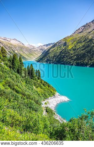 Vivid Blue Mountain Lake In Summer Alps. Speicher Zillergrundl Dam, Zillertal Alps, Austria