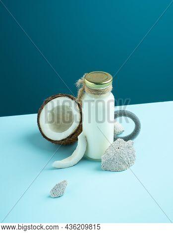 Still Life. Creative Minimalistic Concept Alternative Milk, Coconut Products. Cracked Open Coconut W
