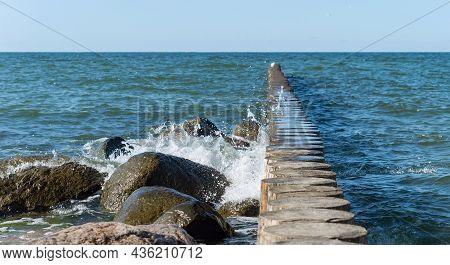 Waves And A Storm At Sea. Waves Crashing On Breakwaters. Sea Wave Splashing. Baltic Sea.