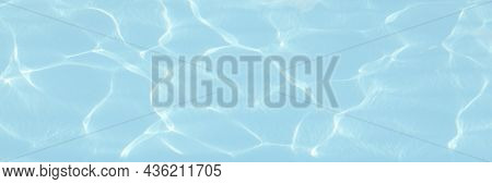Water Background. Blue Swiming Pool Pattern With Natural Rippled Water Texture. Top View With Copy S