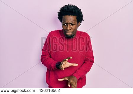 Young african american man wearing casual clothes disgusted expression, displeased and fearful doing disgust face because aversion reaction.