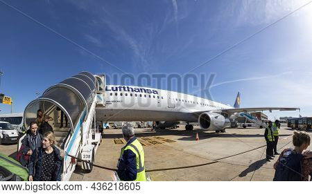 Lisbon, Portugal - March 9, 2020: People Deboard From Lufthansa Aircraft At Airport Of Lisbon.