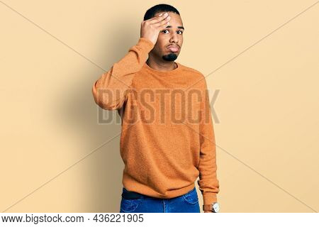 Young african american man wearing casual clothes worried and stressed about a problem with hand on forehead, nervous and anxious for crisis