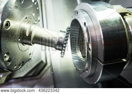 gear skiving operation on cnc machine in metalworking industry. Cutting tool makes internal tooth with mill