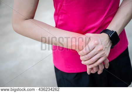 Close Up Of Woman Holding Her Wrist Because Of Wrist Pain. Conceptual Of Woman Suffering Painful Cau