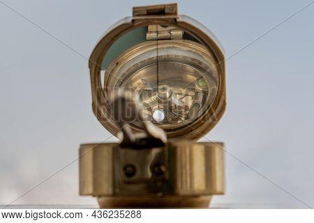 Antique Bronze Emblem Compass (old Compass) Sky Background. Copy Space. Vintage Style. Selective Foc
