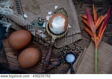 Boiled Eggs With Salt And Pepper On Beautiful Wooden Background, Nutrition Concept. Oblique View Fro
