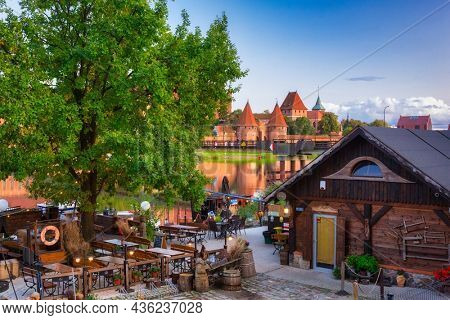 Malbork, Poland - September 18, 2019: Traditional wooden restaurant at the Malbork castle, Poland. The Castle of the Teutonic Order in Malbork is the largest castle in the world measured by land area