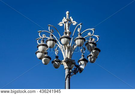 Beautiful Vintage Lamp Post With Swirls And Curls Against Sky. Decoration Of Streets And Parks. Illu