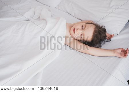 The Child Sleeps Sweetly In Bed. Sleeping Children In The Bed Of Parents. The Child Sleeps Soundly O