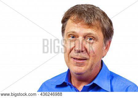 Portrait Of Handsome Caucasian Senior Man With Blue Shirt