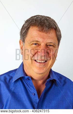 Portrait Of A Handsome Older Man Looking At Camera And Smile