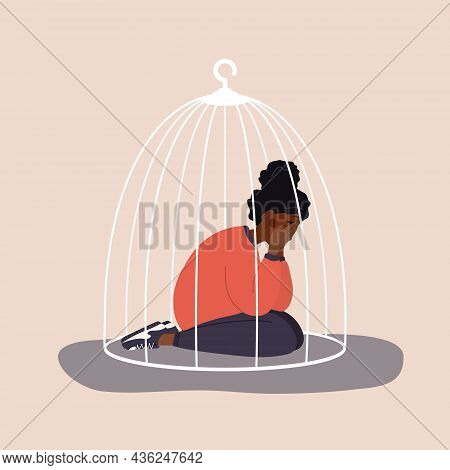 African Woman Locked In Cage. Sad Teenager Sitting On Floor And Crying. Social Isolation Concept. Fe