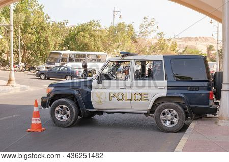 Police Checkpoint On The City Road In The Tourist Part Of Hurghada. Egyptian Police Are Checking Pas