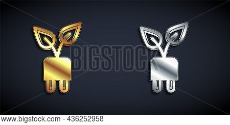 Gold And Silver Electric Saving Plug In Leaf Icon Isolated On Black Background. Save Energy Electric