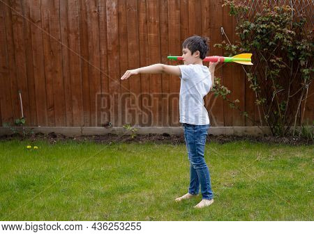 Active Kid Preparing To Throwing A Javelin, Healhty Child Practicing Athletics Throw Javelin. Young