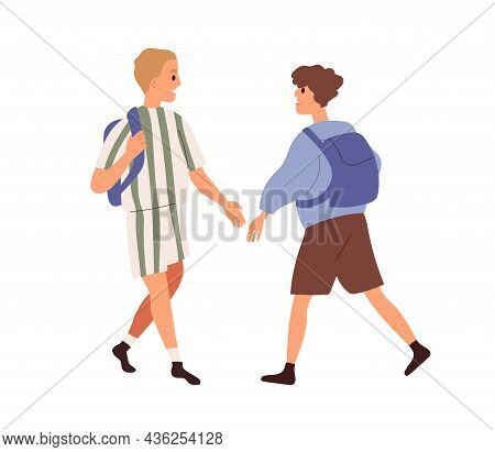 Junior Schoolkids With Schoolbags Meeting And Greeting. Boys Going To And From School. Happy Childre