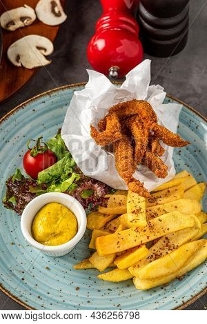 Deep Fried Chicken With French Fries And Salad