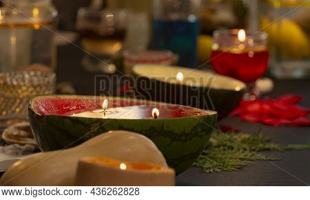 Close-up Flame Shooting Inside Vegetables And Fruits Turning Them Into Original Decorative Candles.