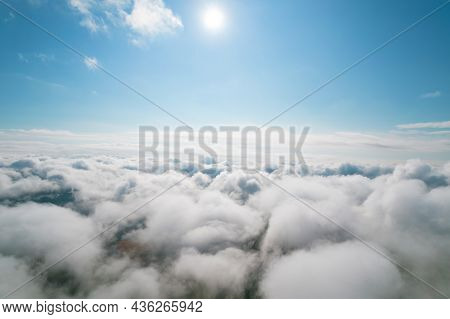 Cumulus Clouds, Aerial Background. Aerial Shot With Top View Of White Fluffy Clouds Gathering. In Be