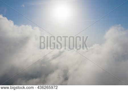 Aerial Shot Of White Fluffy Clouds And Some Blue Sky In Distance While Flying Above Clouds. Beautifu