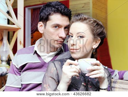 Young Lovers Couple In Cafe