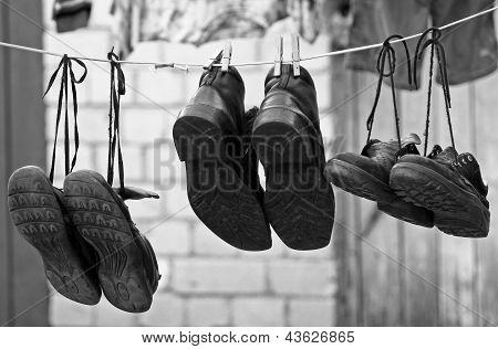 Three Pairs Of Old Shoes