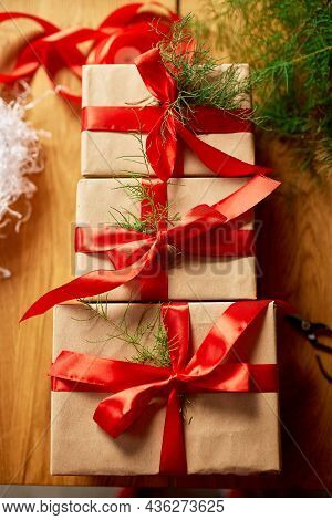 Christmas Eco Friendly Packaging Kraft Paper And Fir Branches Gifts For The Holiday Season